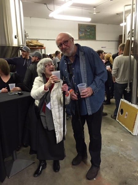 Rita Kohn, author, Indiana beer expert, and conference panelist, offers cheers to John Hill, founder of Broad Ripple Brewpub, Indiana's oldest continuously operating brewery.