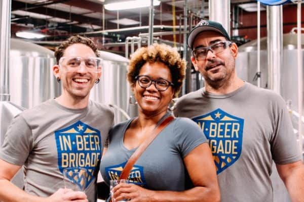 The Brewers of Indiana Guild staff: Tristan Schmid (Communications Director), Iris Dillon (Events Coordinator), Rob Caputo (Executive Director).